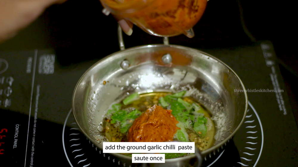 add poondu chutney paste to tadka