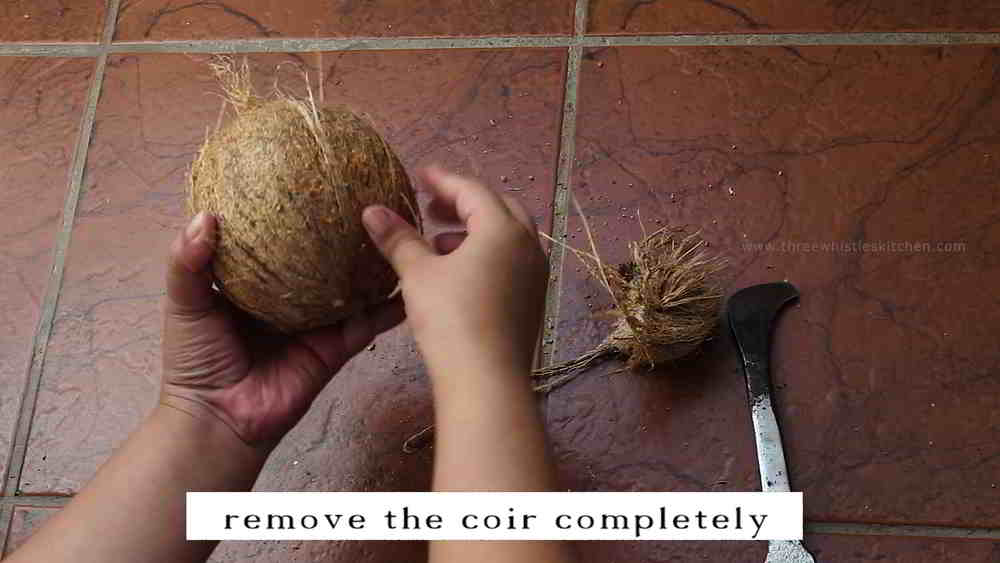 breaking open coconut